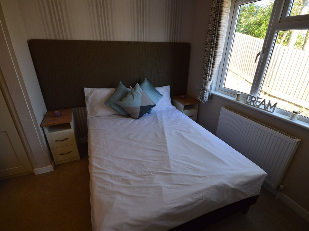 washer dryer and raised level oven. The lounge and dining areas have free standing furniture and provide a warm