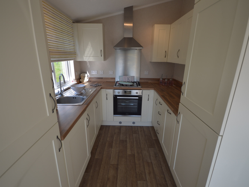 behind which you find the en-suite bathroom with full sized shower unit.  There is a full length bath tub in the main bathroom.  The kitchen features an integrated dishwasher