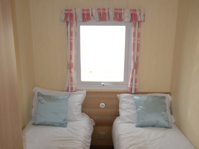 It also features a second bedroom – perfect for family holidays! There's also a further twin bedroom